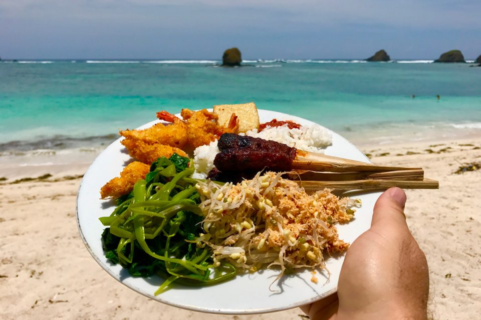 A plate of Indonesia food by the beach
