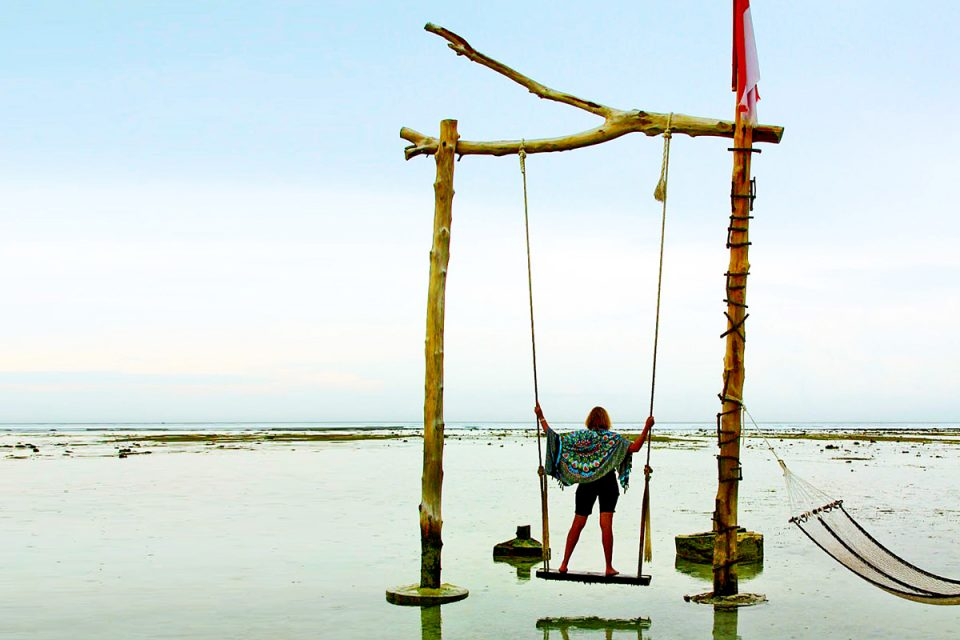 On the famous swing on Gili T, Indonesia