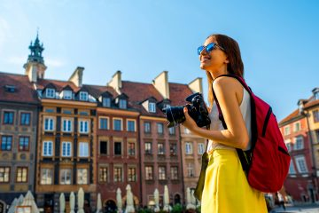 A woman taking photos in Europe
