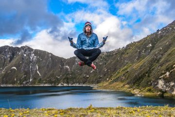 Jared Reichbaum floating above a lake