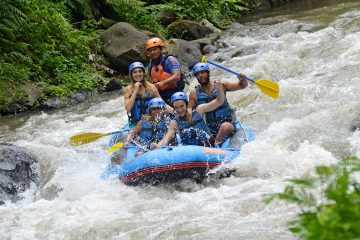 A group of people white water rafting