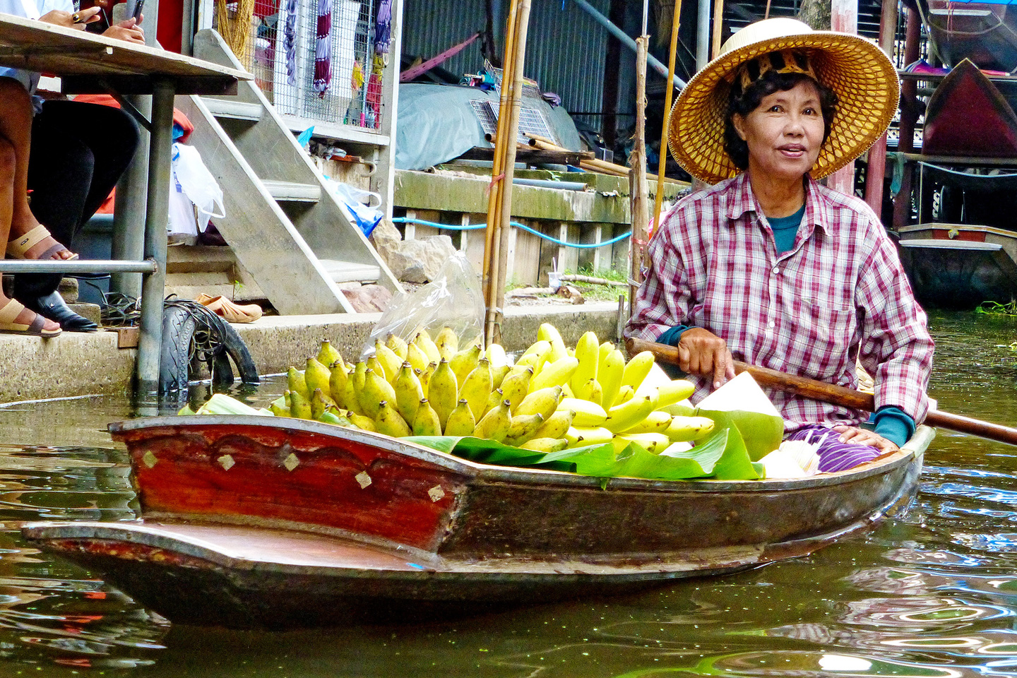 Local woman selling bananas from a boat