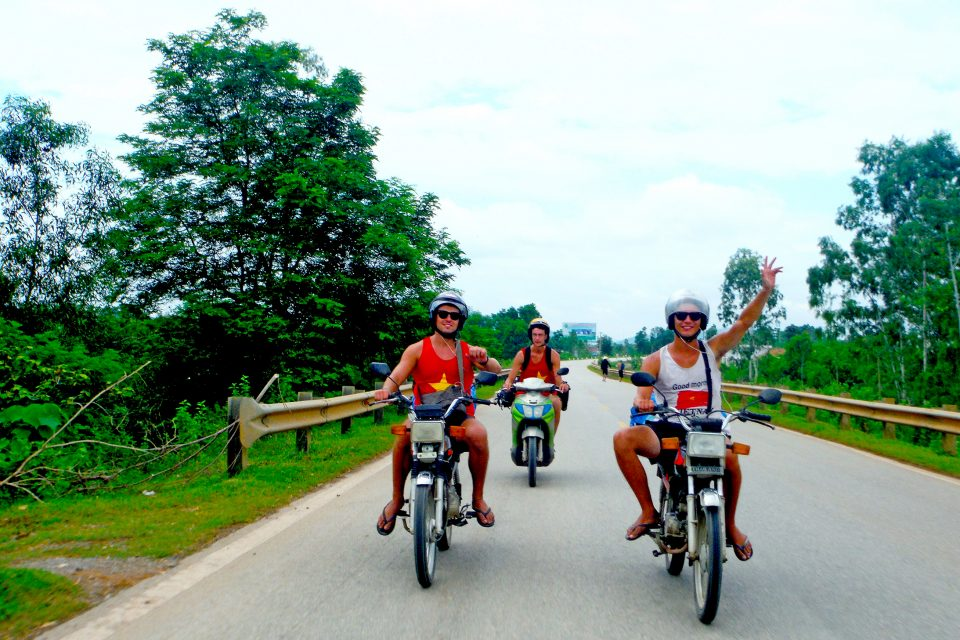 A group of men riding motorbikes towards the camera