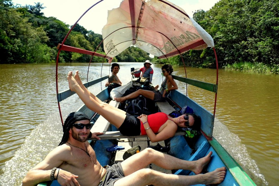 A group of people relaxing on a boat