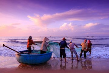 Fishermen casting a net in the sea