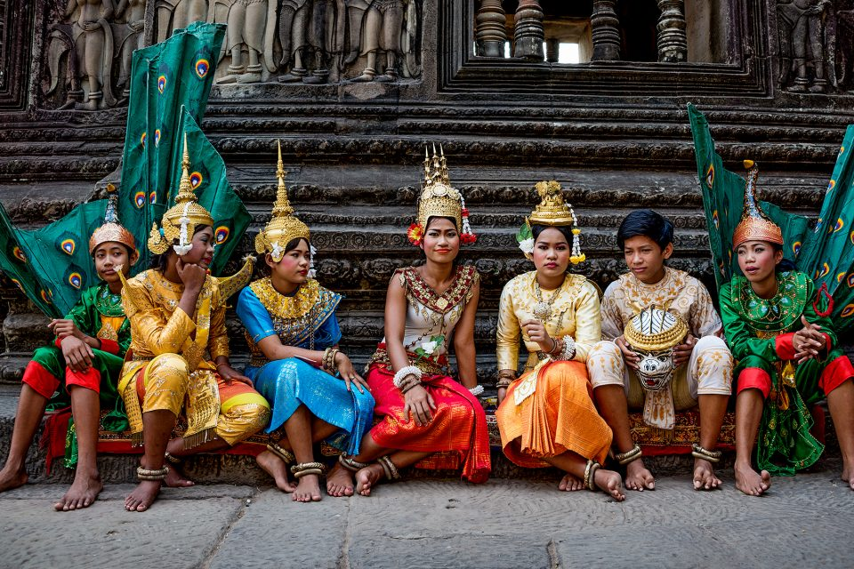 Local people sitting on steps in festival dress