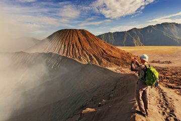 A man taking a photo of Mount Bromo